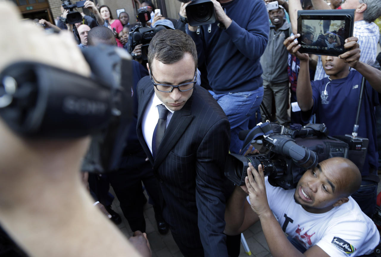 Oscar Pistorius leaves the high court in Pretoria, South Africa, Thursday, Aug. 7, 2014. The chief prosecutor said Thursday the double-amputee athlete's lawyers have floated more than one theory in a dishonest attempt to defend against a murder charge for his killing of girlfriend Reeva Steenkamp. (AP Photo/Themba Hadebe)