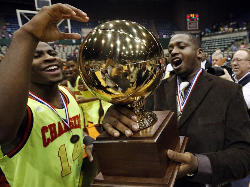 Callaway guard Malik Newman (14) and coach David Sanders hold the trophy as they celebrate Callaway's 49-33 win over Vicksburg in the MHSAA boys' Class 5A championship basketball game in Jackson, Miss., Friday, March 14, 2014