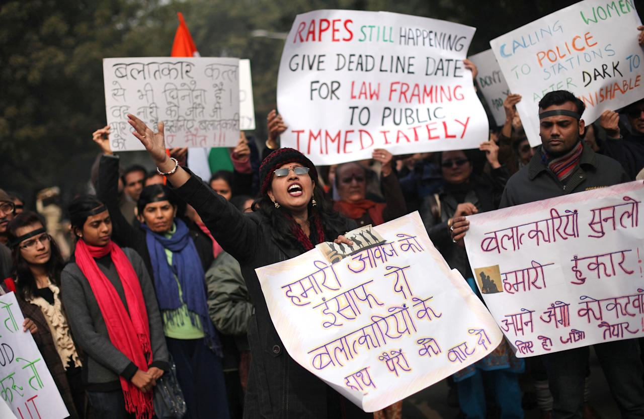 An Indian woman shouts slogans during a protest to mourn the death of a gang rape victim in New Delhi, India, Thursday, Jan. 3, 2013. Indian police were preparing Thursday to file rape and murder charges against a group of men accused of sexually assaulting the 23-year-old university student for hours on a moving bus in New Delhi. The Dec. 16 attack on the woman, who later died of her injuries, has caused outrage across India, sparking protests and demands for tough new rape laws, better police protection for women and a sustained campaign to change society's views about women. (AP Photo/Altaf Qadri)