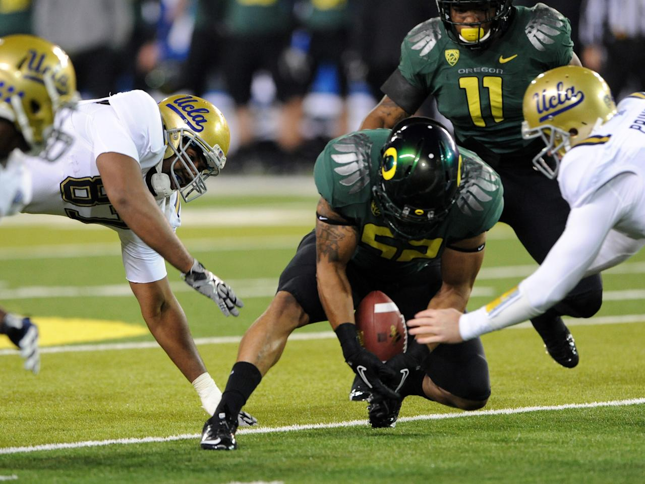 EUGENE, OR - DECEMBER 02 : Linebacker Dewitt Stuckey #52 of the Oregon Ducks recovers a fumble in the first quarter of the Pac-12 Championship game against the UCLA Bruins at Autzen Stadium on December 2, 2011 in Eugene, Oregon. (Photo by Steve Dykes/Getty Images)