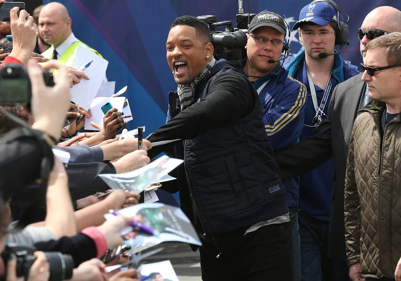 LONDON, ENGLAND - MAY 25:  Will Smith signs autographs as he attends UEFA's Champions Festival which comes to London to coincide with Wembley hosting the Champions League final at Queen Elizabeth Olympic Park on May 25, 2013 in London, England.  Jaden Smith and Will Smith are in London ahead of the release of their film 'After Earth'.  (Photo by Tim P. Whitby/Getty Images)