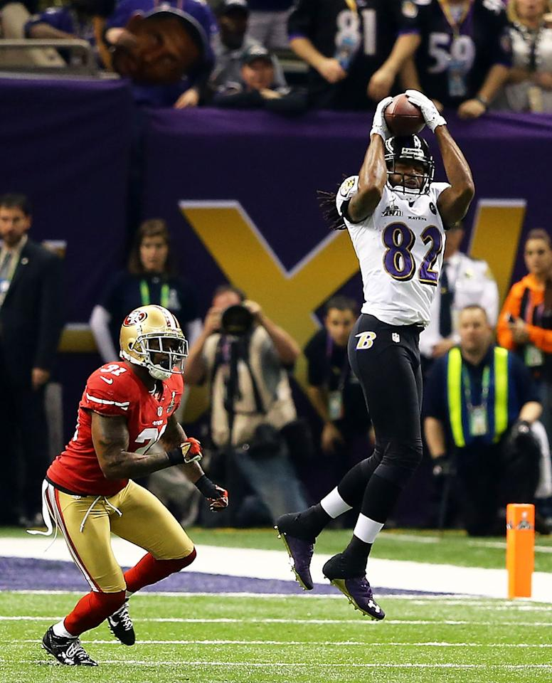 Torrey Smith #82 of the Baltimore Ravens makes a catch in the first quarter against Donte Whitner #31 of the San Francisco 49ers during Super Bowl XLVII at the Mercedes-Benz Superdome on February 3, 2013 in New Orleans, Louisiana.  (Photo by Al Bello/Getty Images)