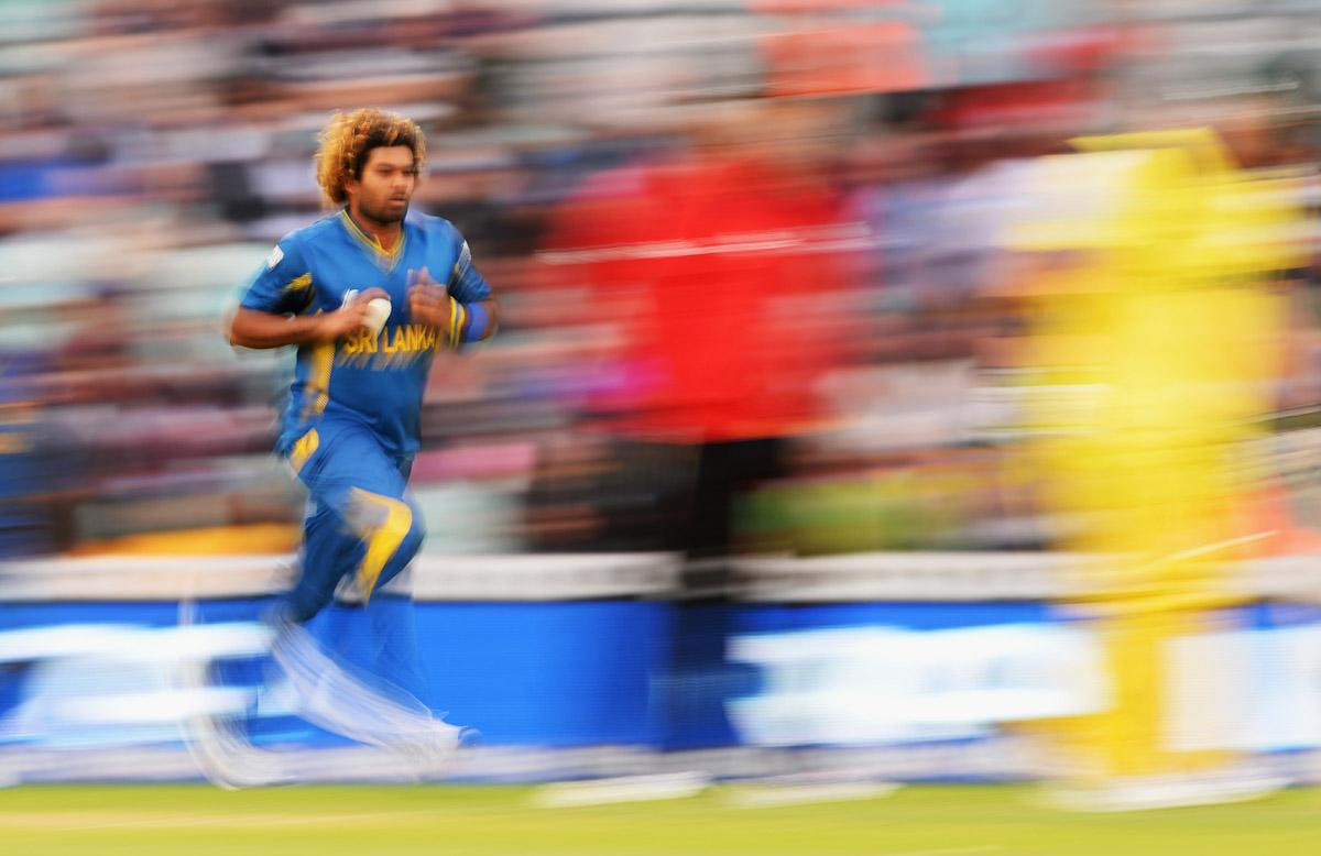 LONDON, ENGLAND - JUNE 17:  Lasith Malinga of Sri Lanka charges in to bowl during the ICC Champions Trophy Group A fixture between Sri Lanka and Australia at The Kia Oval on June 17, 2013 in London, England.  (Photo by Mike Hewitt/Getty Images)