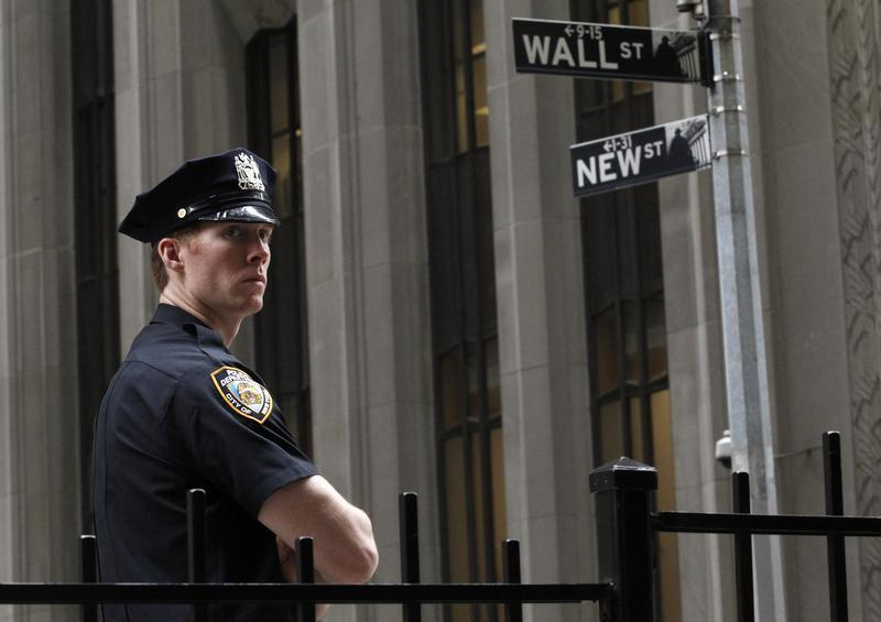 A New York City police officer stands outside the New York Stock Exchange
