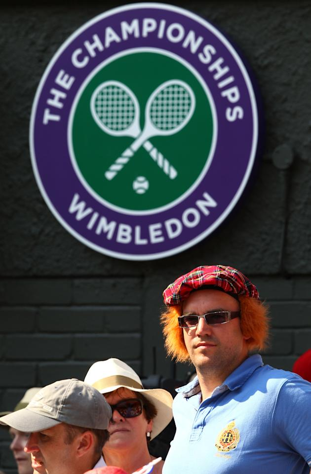 LONDON, ENGLAND - JULY 07: Supporters of Andy Murray of Great Britain watch his Gentlemen's Singles Final match against Novak Djokovic of Serbia on day thirteen of the Wimbledon Lawn Tennis Championships at the All England Lawn Tennis and Croquet Club on July 7, 2013 in London, England. (Photo by Clive Brunskill/Getty Images)