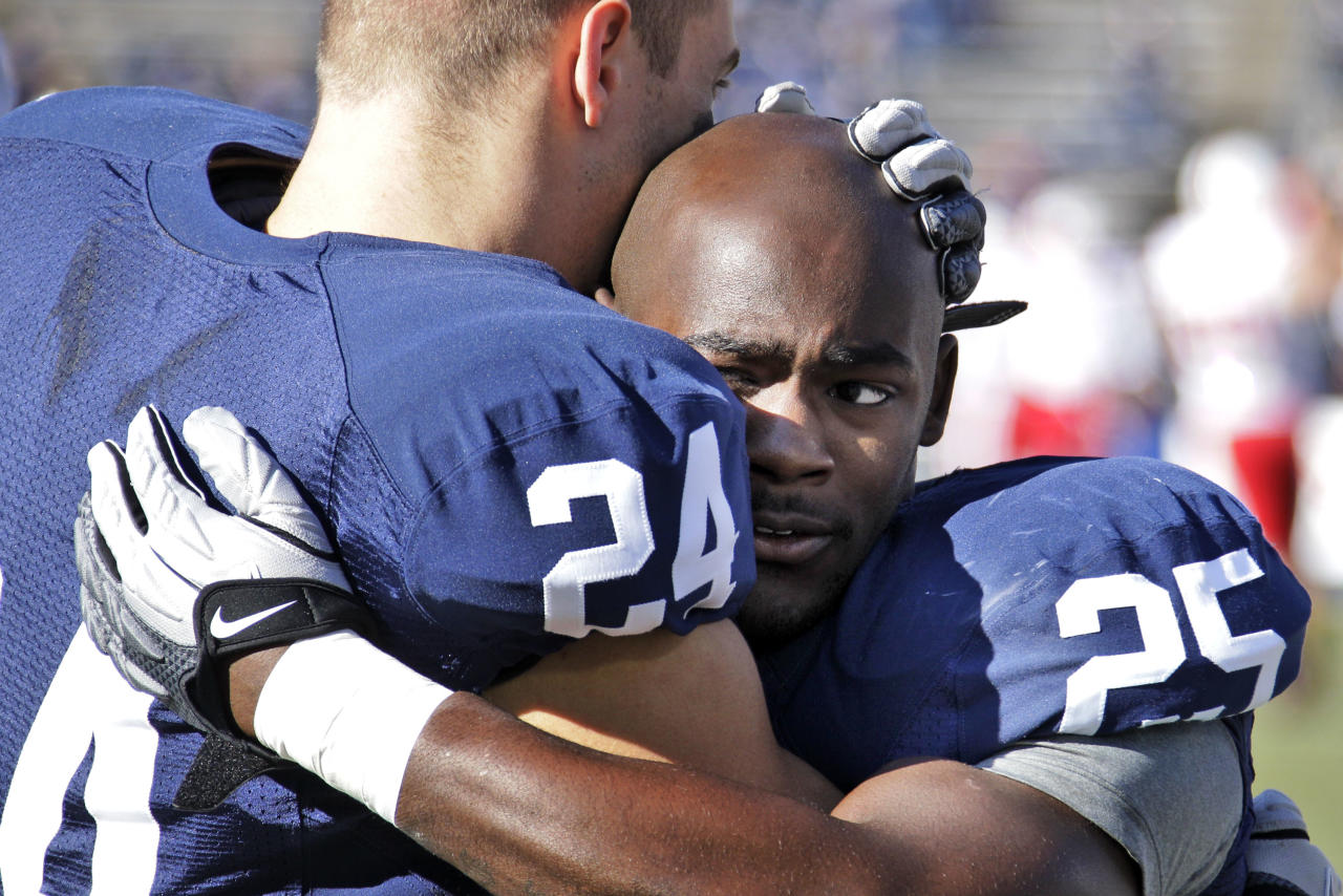 Penn State running backs Derek Day (24) and Silas Redd (25) embrace during warm ups before an NCAA college football game against Nebraska at State College, Pa., Saturday, Nov. 12, 2011. (AP Photo/Gene J. Puskar)