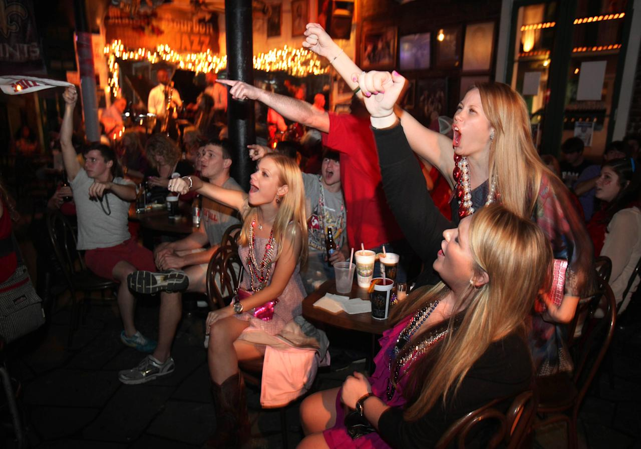 Alabama fans cheer on Bourbon Street in the French Quarter of New Orleans, as the BCS title college football game between Alabama and LSU gets underway at the Superdome, Monday, Jan. 9, 2012. (AP Photo/Kerry Maloney)