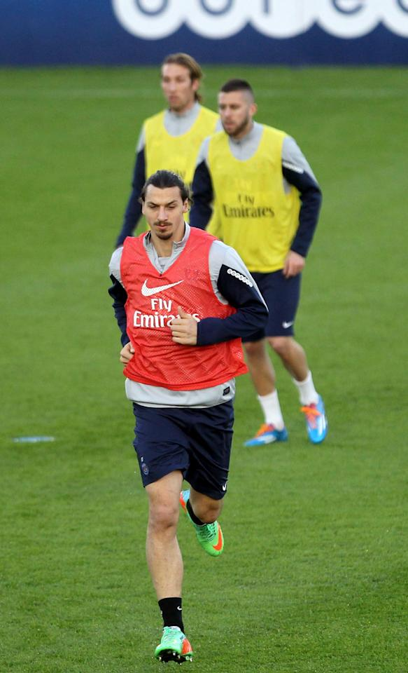 Paris Saint-Germain's player Zlatan Ibrahimovic trains during a training session at the Aspire Academy of Sports Excellence in Doha, Qatar, Monday, Dec. 30, 2013. (AP Photo)
