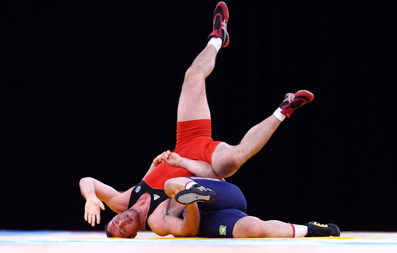 LONDON, ENGLAND - DECEMBER 10:  Riza Kayaalp of Turkey turns Xenofon Koutsioubas of Greece over in the Men's 120kg Greco Roman during the Wrestling LOCOG Test Event for London 2012 at ExCel on December 10, 2011 in London, England.  (Photo by Julian Finney/Getty Images)