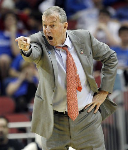Connecticut head coach Jim Calhoun instructs his team in the first half of their NCAA tournament second-round college basketball game against Iowa State in Louisville, Ky., Thursday, March 15, 2012. (AP Photo/Dave Martin)