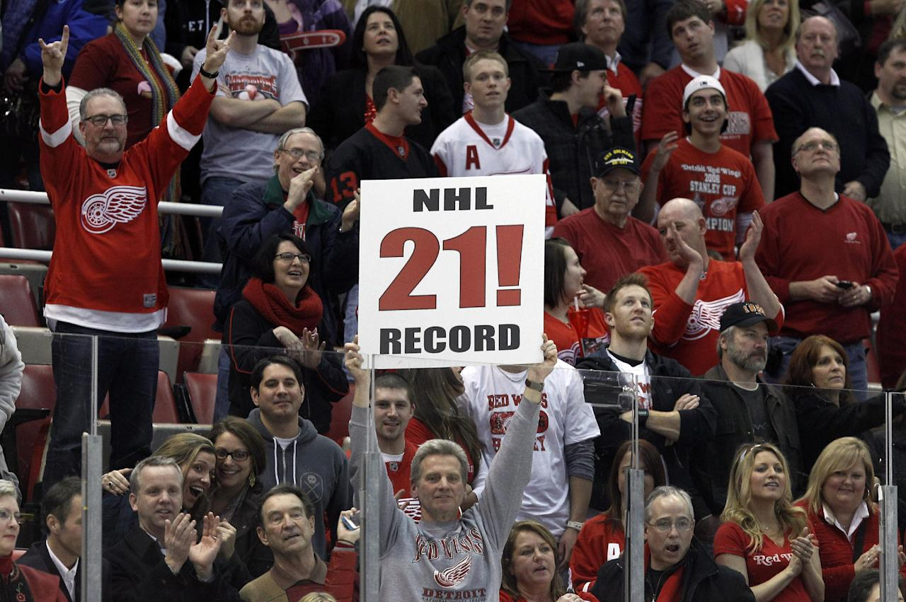 Fans celebrate the Detroit Red Wings' 3-1 win over the Dallas Stars in an NHL hockey game in Detroit, Tuesday, Feb. 14, 2012. Detroit set an NHL record with 21 consecutive home victories. (AP Photo/Paul Sancya)