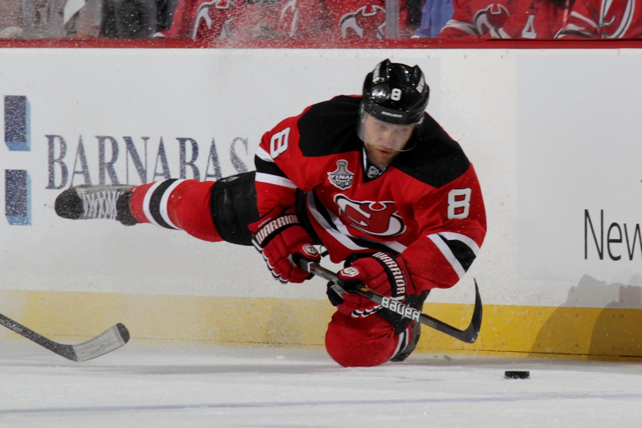 NEWARK, NJ - MAY 30: Dainius Zubrus #8 of the New Jersey Devils falls while handling the puck against the Los Angeles Kings during Game One of the 2012 NHL Stanley Cup Final at the Prudential Center on May 30, 2012 in Newark, New Jersey.  (Photo by Bruce Bennett/Getty Images)
