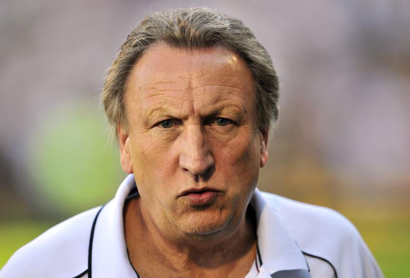 Former Queens Park Rangers' manager Neil Warnock attends a Premier League match against Fulham at Craven Cottage in London on October 2, 2011