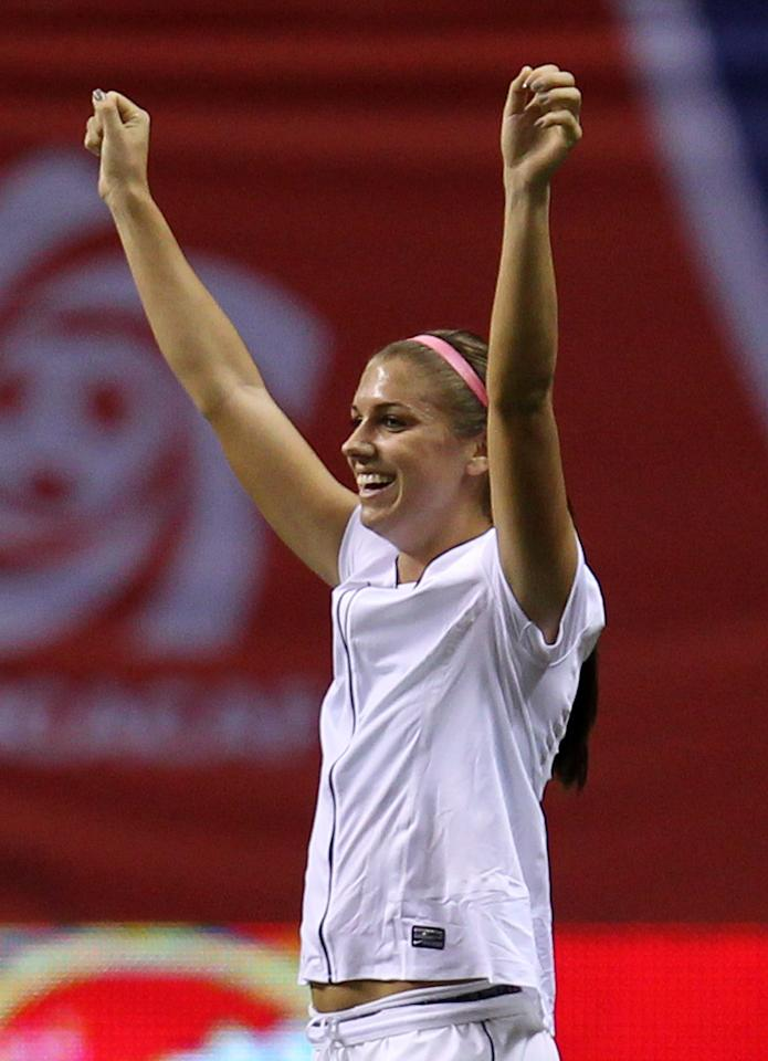 United States' Alex Morgan (13) celebrates her team's 3-0 win over Costa Rica in CONCACAF women's Olympic qualifying soccer game action at B.C. Place in Vancouver, British Columbia, Friday, Jan. 27, 2012. (AP Photo/The Canadian Press, Jonathan Hayward)