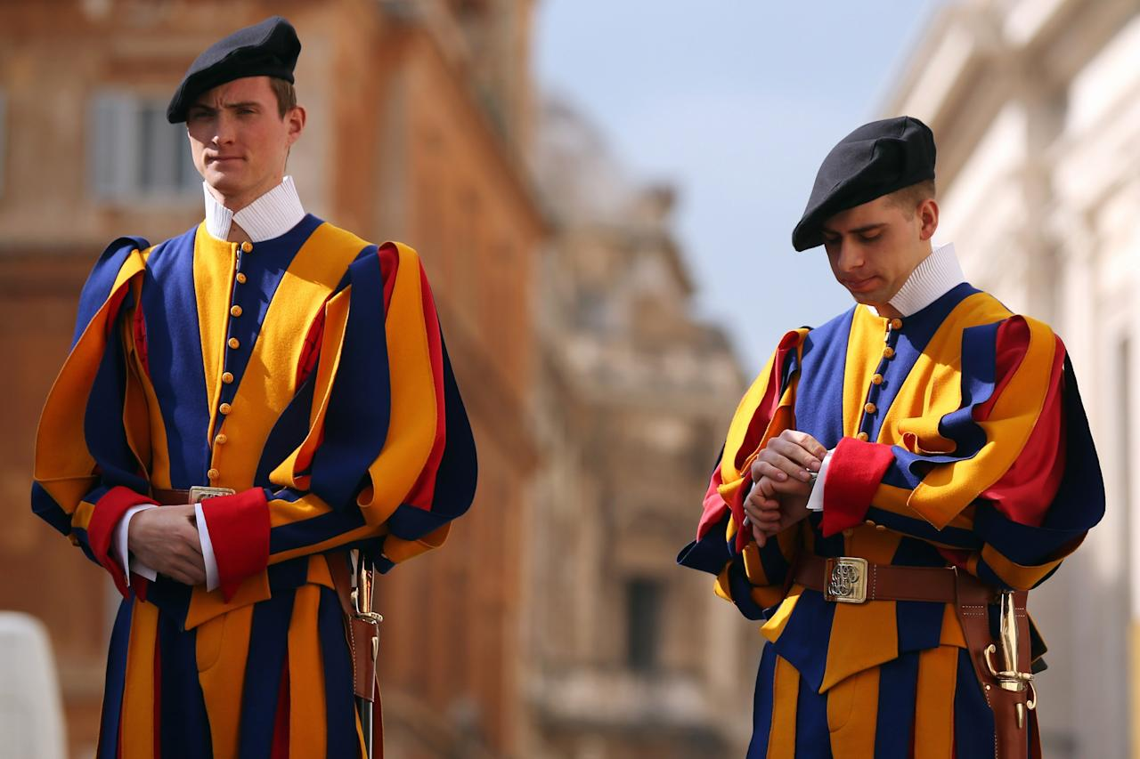 VATICAN CITY, VATICAN - FEBRUARY 26:  Members of the Swiss Guard stand at a vehicle entrance at the edge of Saint Peter's Square ahead of Pope Benedict XVI's last public audience on February 26, 2013 in Vatican City, Vatican. The Pontiff will hold his last weekly public audience on February 27, 2013 before he retires the following day. Pope Benedict XVI has been the leader of the Catholic Church for eight years and is the first Pope to retire since 1415. He cites ailing health as his reason for retirement and will spend the rest of his life in solitude away from public engagements.  (Photo by Oli Scarff/Getty Images)