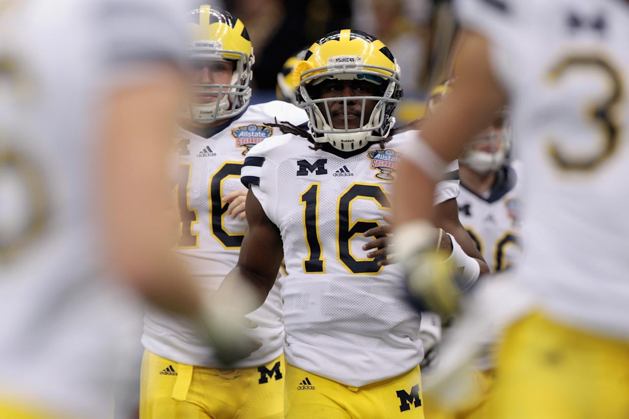 NEW ORLEANS, LA - JANUARY 03:  Denard Robinson #16 of the Michigan Wolverines runs on the field during warm ups against the Virginia Tech Hokies during the Allstate Sugar Bowl at Mercedes-Benz Superdome on January 3, 2012 in New Orleans, Louisiana.  (Photo by Chris Graythen/Getty Images)