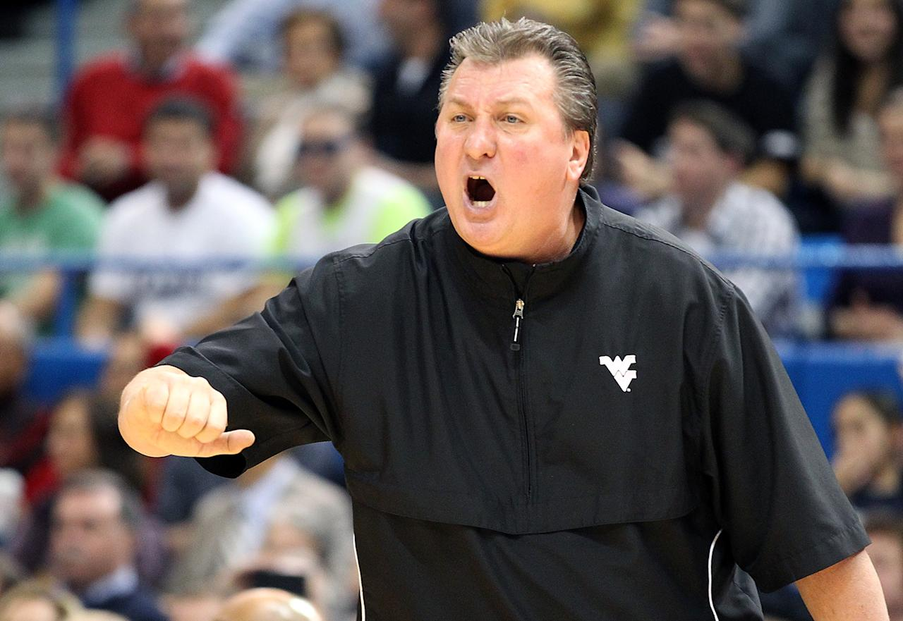 Bob Huggins of the West Virginia Mountaineers reacts to an official's call during a game with the Connecticut Huskies in the second half at the XL Center on January 9, 2012 in Hartford, Connecticut.  (Photo by Jim Rogash/Getty Images)