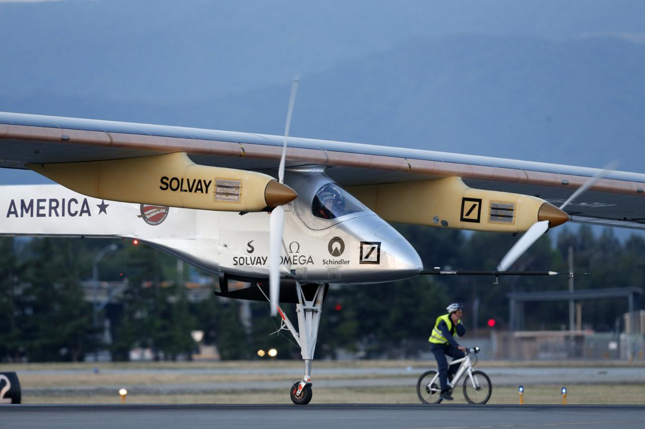 MOUNTAIN VIEW, CA - MAY 03: Pilot Bertrand Piccard takes off in the Solar Impulse solar electric airplane at Moffett Field on May 3, 2013 in Mountain View, California.   Pilots Bertrand Piccard and Andre Borschberg are attempting the first cross-continental flight in a solar powered plane that can travel day and night. (Photo by Beck Diefenbach/Getty Images)