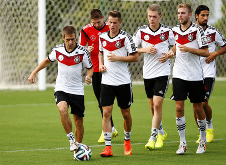 Germany's national soccer team player Lahm and his teammates run during a training session in the village of Santo Andre