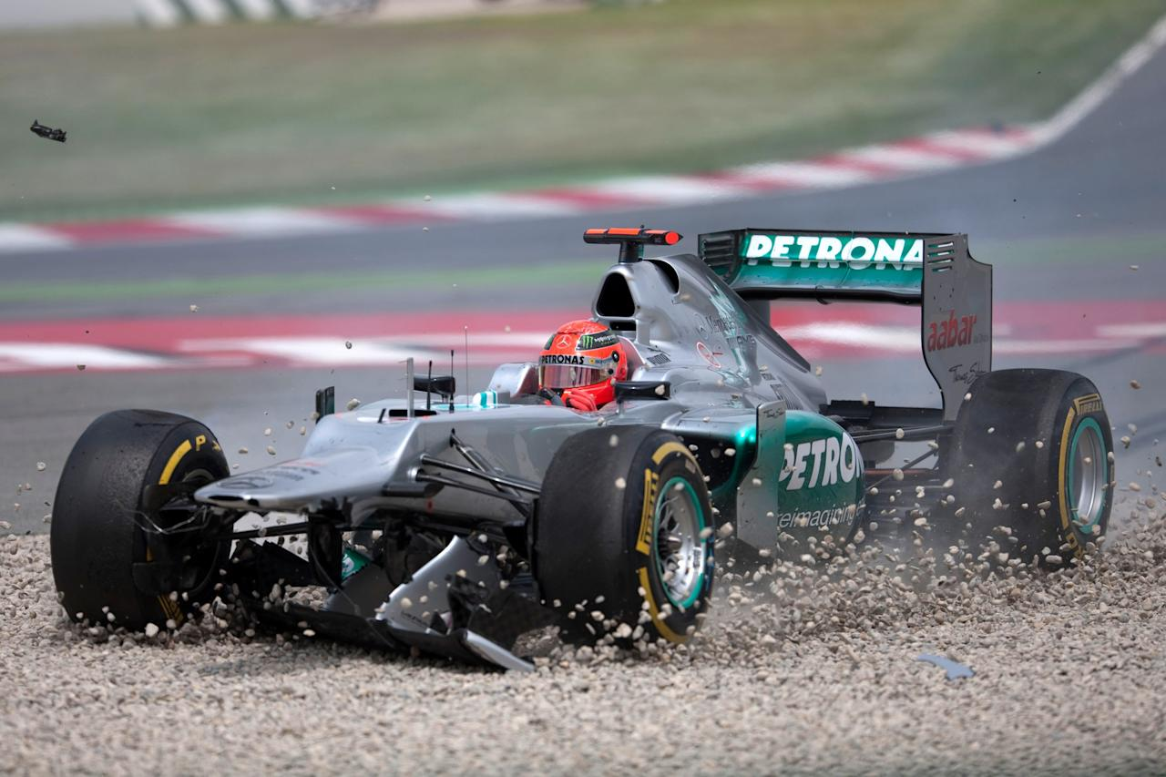 BARCELONA, SPAIN - MAY 13:  Michael Schumacher crashes out of the Spanish Formula One Grand Prix at the Circuit de Catalunya on May 13, 2012 in Barcelona, Spain.  (Photo by Peter J Fox/Getty Images)