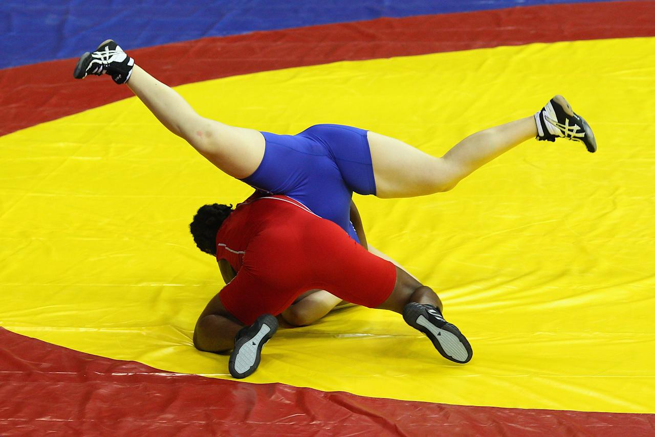 Emma Chalmers of Australia competes against Ifeoma Iheanacho of Nigeria in the women's 67kg 3-5 final at IG Sports Complex during day five of the Delhi 2010 Commonwealth Games on October 8, 2010 in Delhi, India.  (Photo by Cameron Spencer/Getty Images)