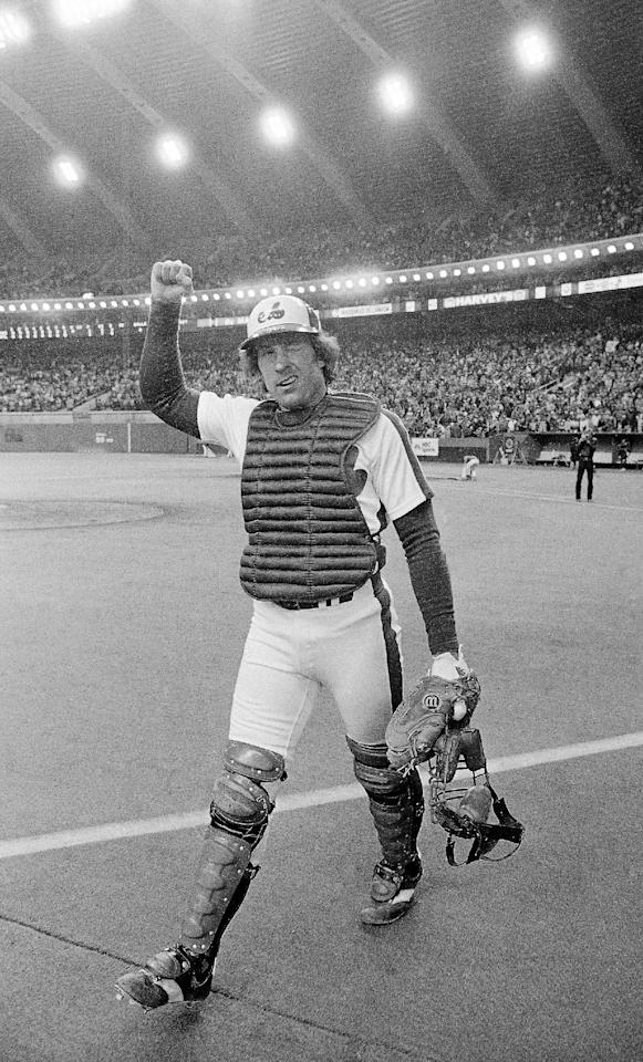 FILE - In t his Oct. 9, 1981, file photo, Montreal Expos catcher Gary Carter winks at the cheering crowd and gives them the clenched fist salute as he leaves the field after the Expos defeated the Philadelphia Phillies 3-1 to take a 2-0 lead in the National League East Division playoffs Montreal. Carter's third inning two-run homer proved to be the game winner. Baseball Hall of Fame president Jeff Idelson said Thursday, Feb. 16, 2012, that Hall of Fame catcher Gary Carter has died. He was 57. (AP Photo/Bill Grimshaw, File)