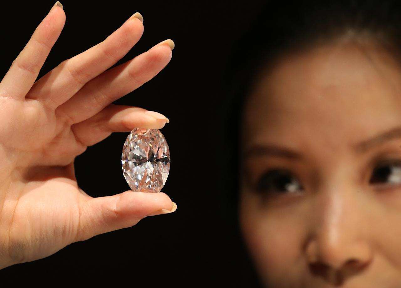 LONDON, ENGLAND - SEPTEMBER 09: A Sotheby's employee holds the largest D colour, Flawless, Type IIa white oval diamond to come to auction on September 9, 2013 in London, England. The 118.28 carat stone will be offered for auction in Hong Kong at their Magnificent Jewels and Jadeite sale on October 7, 2013. (Photo by Peter Macdiarmid/Getty Images)