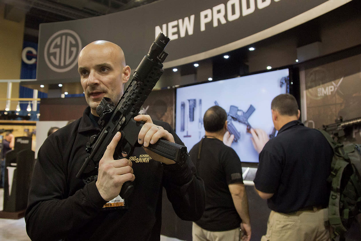 Sig Sauer representative Adam Painchaud explains one of the company's newest products, the MPX 9mm pistol caliber submachine gun.