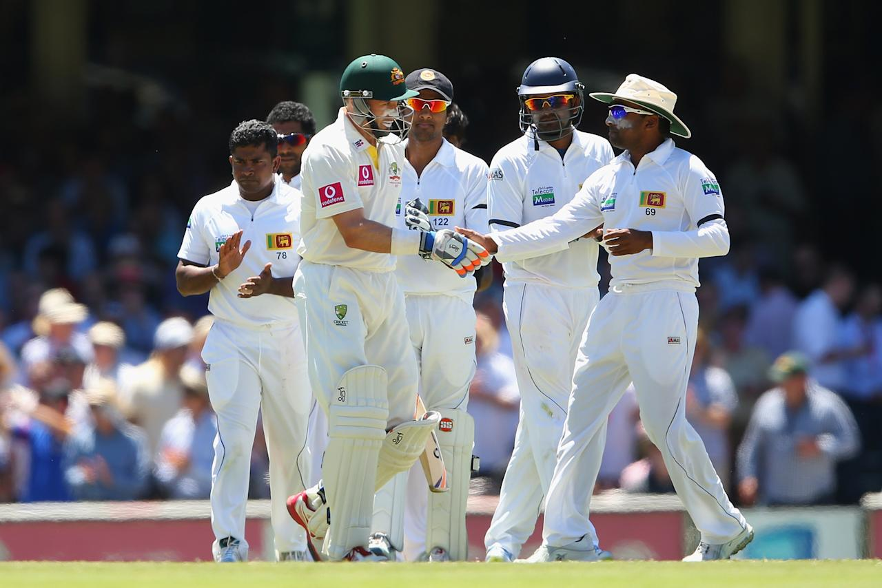 SYDNEY, AUSTRALIA - JANUARY 04:  Michael Hussey of Australia walks through a guard of honour onto the pitch shaking hands with Sri Lanka captain Mahela Jayawardene in his last test match during day two of the Third Test match between Australia and Sri Lanka at Sydney Cricket Ground on January 4, 2013 in Sydney, Australia.  (Photo by Cameron Spencer/Getty Images)