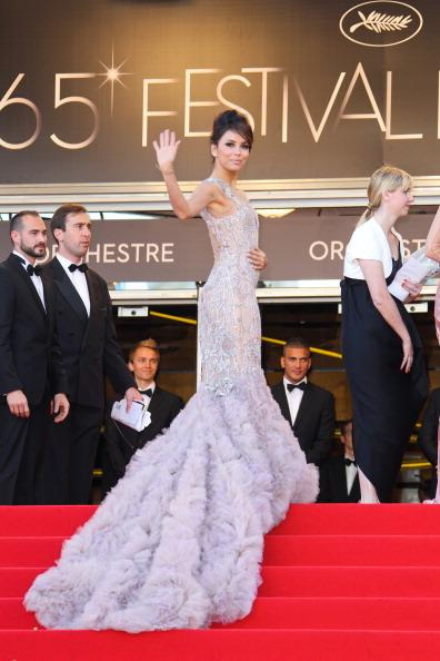 "<div class=""caption-credit""> Photo by: Getty Images</div><div class=""caption-title"">Eva Longoria at Cannes</div>She may not have had a participating movie at the renowned film festival, but this Mexican-American stole the show with her gorgeous red carpet gowns. This light lavender Marchesa with feathered train is one of the reasons her name appeared in many a ""best dressed at Cannes"" list this year"