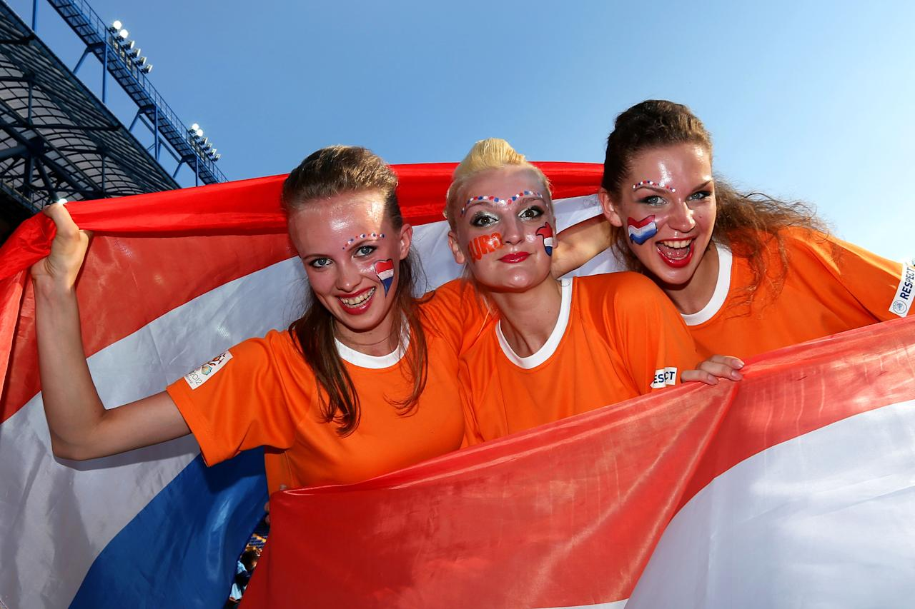 KHARKOV, UKRAINE - JUNE 09:  Dutch fans soak up the atmopshered during the UEFA EURO 2012 group B match between Netherlands and Denmark at Metalist Stadium on June 9, 2012 in Kharkov, Ukraine.  (Photo by Julian Finney/Getty Images)