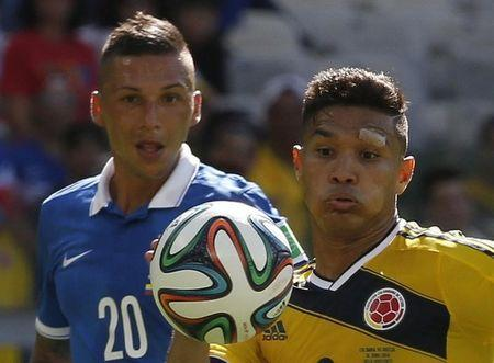 Greece's Holebas and Colombia's Gutierrez fight for the ball during their 2014 World Cup Group C soccer match at the Mineirao stadium in Belo Horizonte