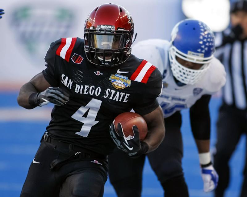San Diego State running back Adam Muema (4) runs the ball past Buffalo linebacker Khalil Mack during the first half of the Famous Idaho Potato Bowl NCAA college football game in Boise, Idaho, on Saturday, Dec. 21, 2013. San Diego State won 49-24