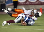 Montreal Alouettes quarterback Chris Leak is sacked by B.C. Lions' Keron Williams during first quarter Canadian Football League action Friday, September 3, 2010 in Montreal. THE CANADIAN PRESS/Ryan Remiorz
