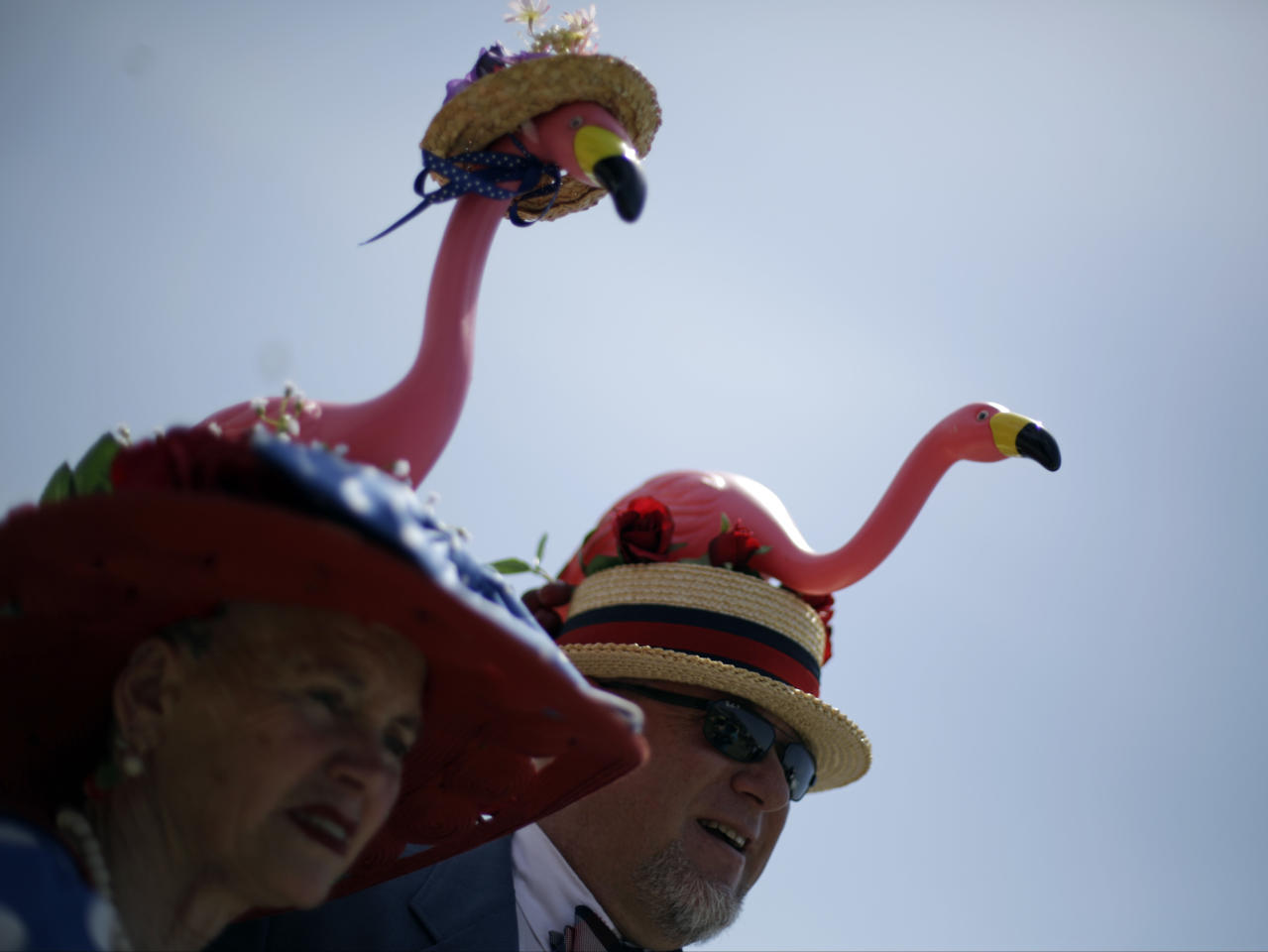 Scott and Jan Baty of Traverse City, Mich., look around before the 140th running of the Kentucky Derby horse race at Churchill Downs Saturday, May 3, 2014, in Louisville, Ky. (AP Photo/David Goldman)