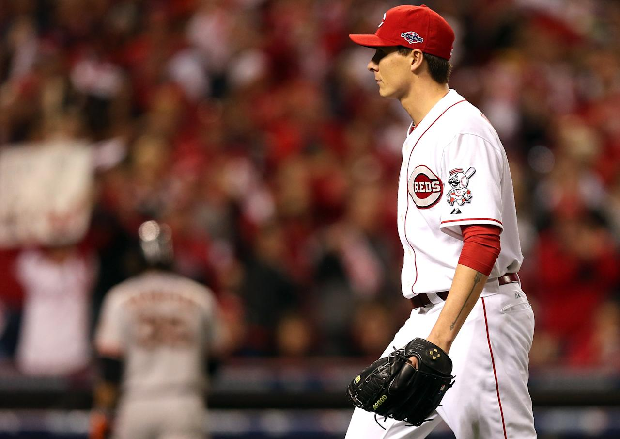 CINCINNATI, OH - OCTOBER 09:  Homer Bailey #34 of the Cincinnati Reds walks to the dugout after striking out Brandon Crawford #35 of the San Francisco Giants to end the fifth inning in Game Three of the National League Division Series at the Great American Ball Park on October 9, 2012 in Cincinnati, Ohio.  (Photo by Jonathan Daniel/Getty Images)