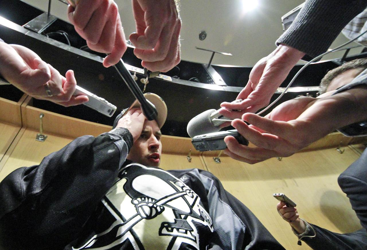 FILE - In this Nov. 21, 2011, file photo, Pittsburgh Penguins captain Sidney Crosby speaks to reporters after a game-day morning skate before his NHL hockey return against the New York Islanders in Pittsburgh. Crosby missed ice time from Jan. 5 until Nov. 21 after hits to the head in consecutive games led to a concussion. Crosby has been out since Dec. 5 and is now back on the injured list because of a recurrence of concussion-like symptoms. Hard hits leading to concussions have contributed to the NHL's struggles in balancing its fast, physical nature with growing evidence that aggressive play can cause long-lasting damage. (AP Photo/Gene J. Puskar, File)