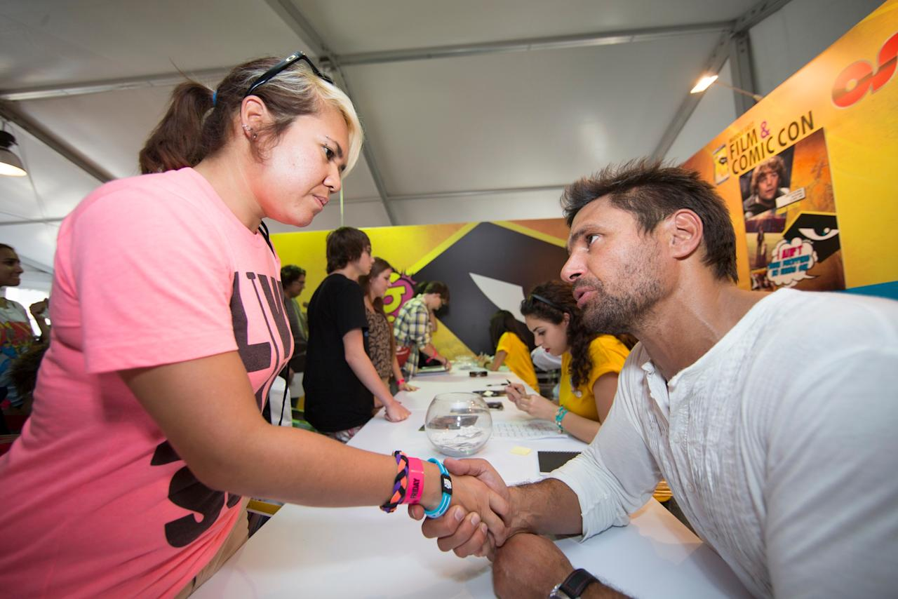 Spartacus, Arrow, and The Hobbit actor, Manu Bennet having an up-close and personal chat with a fan at a signing session during the opening day of the Middle East Film & Comic Con 2013 in Dubai.  Photo: Oliver Clarke/Yahoo! Maktoob.