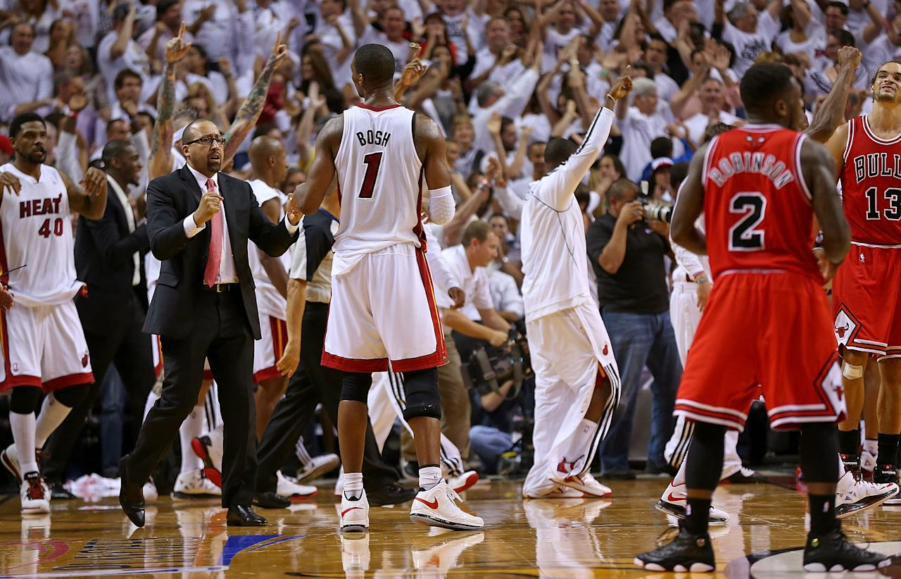 MIAMI, FL - MAY 15:  The Miami Heat celebrate after winning Game Five of the Eastern Conference Semifinals of the 2013 NBA Playoffs against the Chicago Bulls at American Airlines Arena on May 15, 2013 in Miami, Florida. NOTE TO USER: User expressly acknowledges and agrees that, by downloading and or using this photograph, User is consenting to the terms and conditions of the Getty Images License Agreement.  (Photo by Mike Ehrmann/Getty Images)