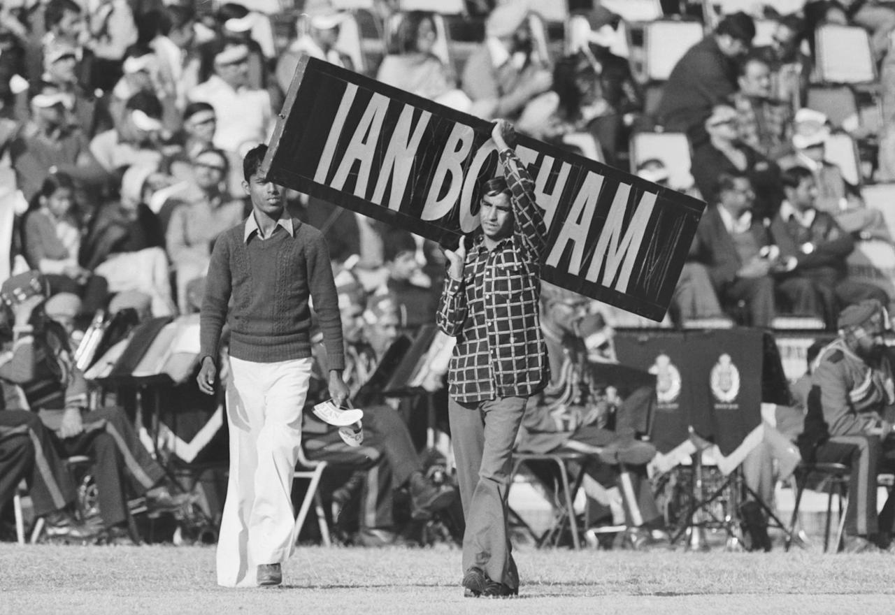 A sign bearing Ian Botham's name is carried aloft at the cricket ground in Jammu, India, December 1981. (Photo by Adrian Murrell/Hulton Archive/Getty Images)