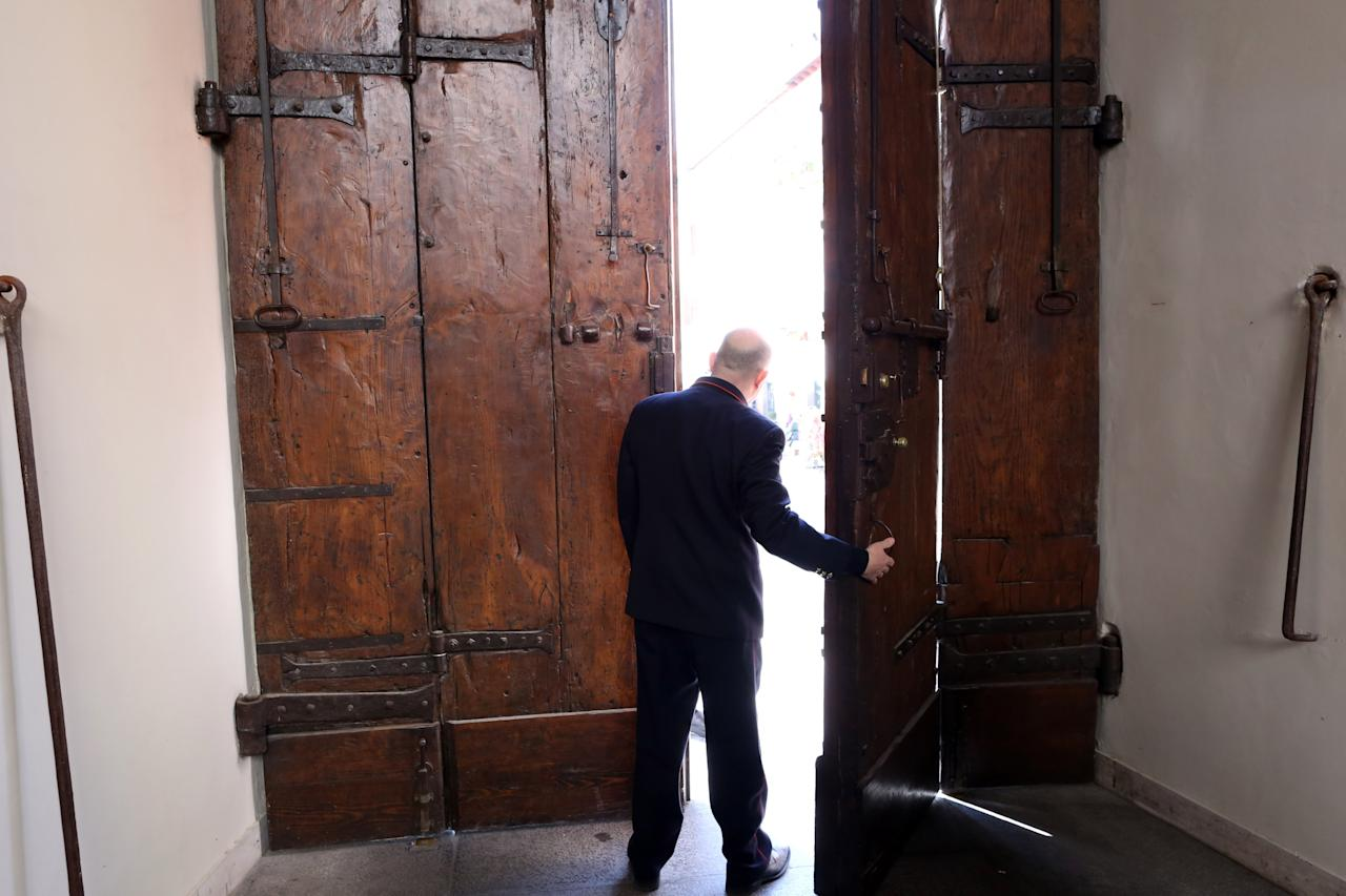 ROME, ITALY - FEBRUARY 20:   A man opens the main door of the Apostolic Palace of Castelgandolfo on February 20, 2013 in Rome, Italy. The Apostolic Palace and The Pontifical Villas of Castelgandolfo, 10 miles south Rome, are the summer residence of Popes and will host  Pope Benedict XVI during the next conclave.  (Photo by Franco Origlia/Getty Images)