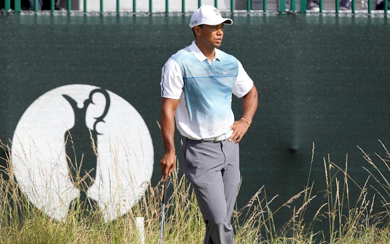 Tiger Woods looks on from the edge of the 3rd green during the opening day of the British Open Golf Championship at Royal Liverpool in Hoylake on July 17, 2014