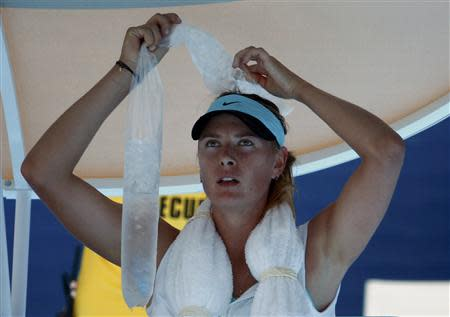 Maria Sharapova of Russia holds ice on her head during her women's singles match against Karin Knapp of Italy at the Australian Open 2014 tennis tournament in Melbourne