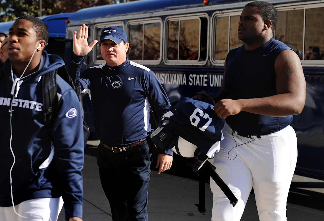 STATE COLLEGE, PA - NOVEMBER 12:  Penn State coach Tom Bradley exits the team bus and enters the stadium before taking on Nebraska at Beaver Stadium on November 12, 2011 in State College, Pennsylvania. Head football coach Joe Paterno was fired amid allegations that former Penn State defensive coordinator Jerry Sandusky was involved with child sex abuse. Penn State is playing their final home football game against Nebraska.  (Photo by Patrick Smith/Getty Images)