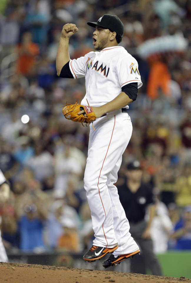 Miami Marlins' Henderson Alvarez celebrates after striking out Detroit Tigers' Matt Tuiasosopo for the last out of the ninth inning of an interleague  baseball game, Sunday, Sept. 29, 2013, in Miami.  Alvarez got a no-hitter as the Marlins won 1-0.  (AP Photo/Alan Diaz)