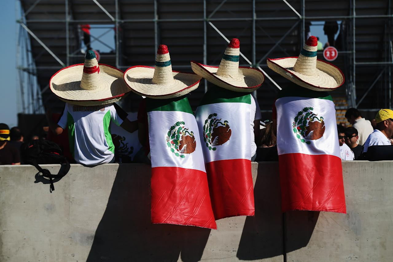 AUSTIN, TX - NOVEMBER 17:  Mexican fans attend the race to support Sergio Perez of Mexico and Sauber F1 during qualifying for the United States Formula One Grand Prix at the Circuit of the Americas on November 17, 2012 in Austin, Texas.  (Photo by Mark Thompson/Getty Images)