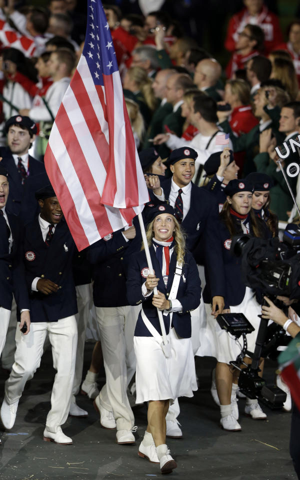 United States's Mariel Zagunis carries the flag during the Opening Ceremony at the 2012 Summer Olympics, Friday, July 27, 2012, in London. (AP Photo/Mark Humphrey)