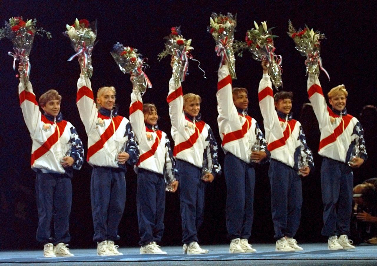 ** FILE ** In this June 30, 1996 file photo, the U.S. Olympic Women's Gymnastic Team waves to the crowd following the team trials in Boston=. From left are Kerri Strug, Jaycie Phelps, Dominique Moceanu, Shannon Miller, Dominique Dawes, Amy Chow and Amanda Borden. The Magnificent Seven will have one of their rare reunions Thursday June 19, 2008, when they're inducted into the U.S. Olympic Hall of Fame. (AP Photo/Susan Walsh, File)