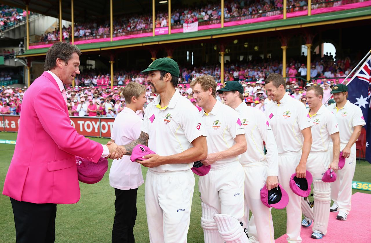 SYDNEY, AUSTRALIA - JANUARY 05:  Mitchell Johnson of Australia presents his Pink Cap to Glenn McGrath on Jane McGrath Day during day three of the Fifth Ashes Test match between Australia and England at Sydney Cricket Ground on January 5, 2014 in Sydney, Australia.  (Photo by Ryan Pierse/Getty Images)