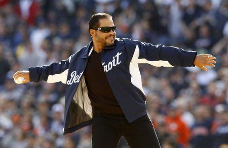 Ivan Rodriguez throws out the ceremonial first pitch before Game 4 of the MLB ALCS baseball playoff series between the New York Yankees and the Detroit Tigers in Detroit, Michigan, October 18, 2012.  REUTERS/Jessica Rinaldi